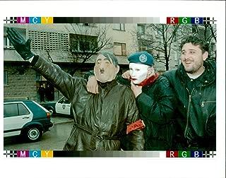 Vintage photo of Yugoslavia Bosnian wearing an Adolf hitler mask.