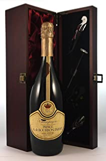 Prince A de Bourbon Parme Vintage Brut Champagne 1979 in a silk lined wooden box with four wine accessories, 1 x 750ml