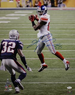 Hakeem Nicks Autographed 16x20 In Air Against Patriots Photo- JSA Authenticated