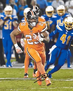 Devontae Booker, Denver Broncos, Signed, Autographed, 8X10 Photo, a Coa with the Proof Photo of Devontae Signing Will Be Included.