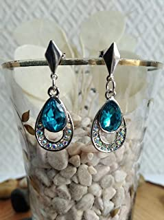 Pendiente de plata y cristal de roca en azul