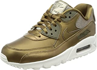 703c8f67b7571a Amazon.com  NIKE - Gold   Shoes   Women  Clothing