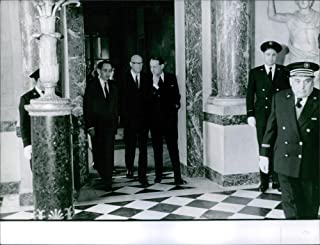 Vintage photo of Portrait of a Finnish writer and President of Finland Urho Kaleva Kekkonen walking with men and coming out from the building. 1967