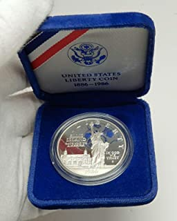 1986 unknown 1986 UNITED STATES Ellis Island Statue of Liberty coin Good Uncertified