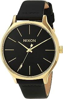 ساعة Nixon Clique النسائية على الموضة للأمام (38 مم. سوار جلدي) أسود/ذهبي/أسود
