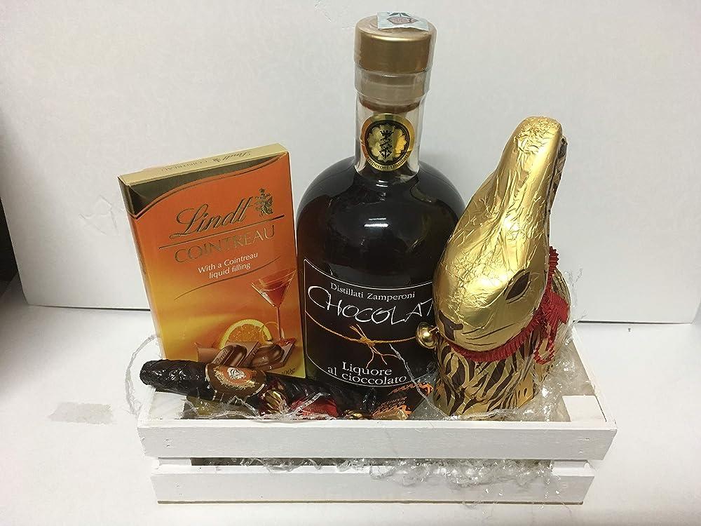 Cesto composizione artigianale per pasqua,con  cassetta legno,1 liguore al cioccolatto piu` lindor cioccolatti