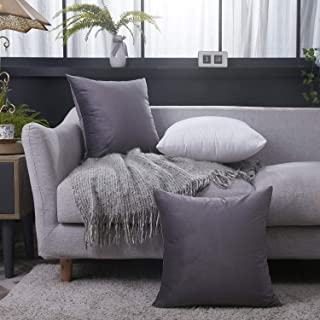 gray and purple decorative pillows