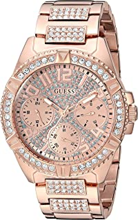 GUESS Rose Gold-Tone Stainless Steel Crystal Watch with Day, Date + 24 Hour Military/Int'l Time. Color: Rose Gold-Tone (Model: U1156L3)