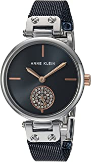 ساعة يد نسائية مع سوار شبكي مرصعة بالكريستال الفاخر من ان كلاين.