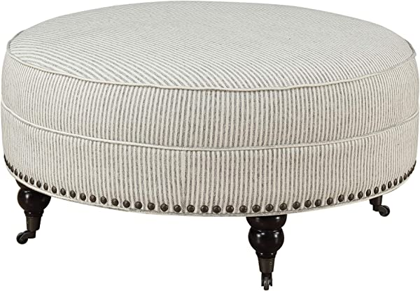 Carthage Round Ottoman In Gray Ivory Stripe With Turned Feet Nailhead Trim And Seam Welting By Artum Hill