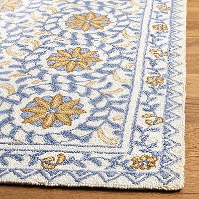 Tapis rectangulaire d'intérieur traditionnel tufté à la main, collection Chelsea, HK150, en ivoire / bleu, 114 X 175 cm pour le salon, la chambre ou tout autre espace intérieur par SAFAVIEH.