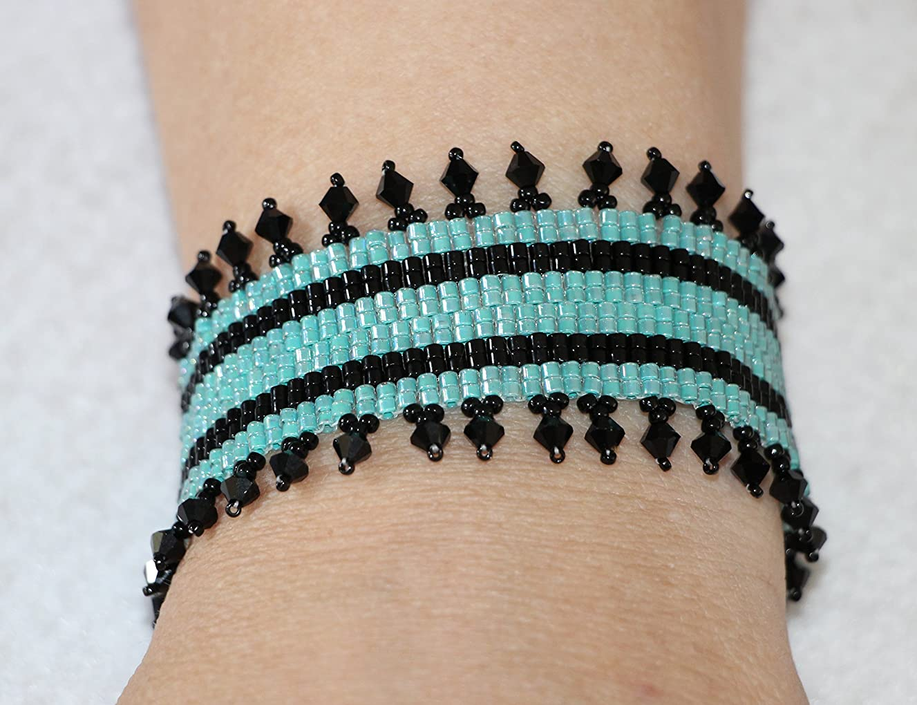 1132. Turquoise and black bead woven cuff bracelet with a toggle clasp.