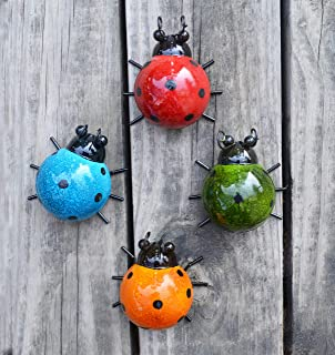 If you're wanting to add a cute factor to your garden, try adding some of these ladybugs to your yard. They are so cute! For more garden art ideas, look here.