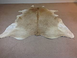 BUTTER CREAM AND WHITE COWHIDE RUG
