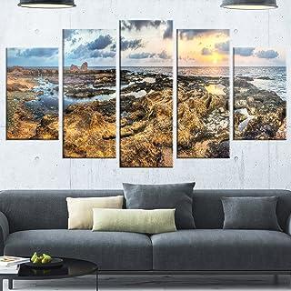 Design Art Rocky African Seashore Panorama - Oversized Beach Glossy Metal Wall Art, 32'' Hx60'' Wx1'' D 5PD, Blue/Orange