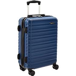 AmazonBasics - Maleta rígida con ruedas, 55 cm, tamaño para cabina, azul marino, apto para la mayoría de las aerolíneas de bajo coste