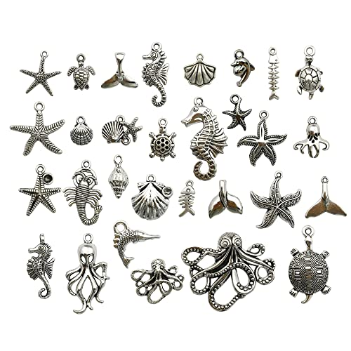 14 different antique silver tone  charms The Shell Charms Collection