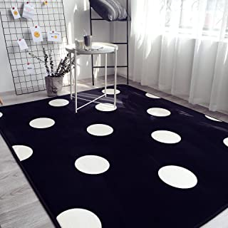 black rug with white polka dots