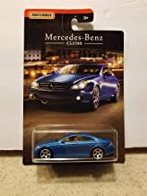 Matchbox 2018 Mercedes-Benz Collection - 4 Door CLS500 Coupe in Matte Gold Finish on Night-Themed Art Card