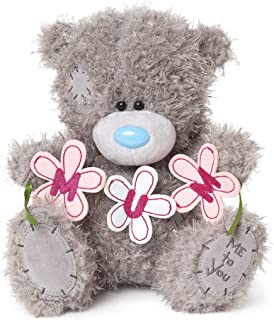 tatty teddy holding flowers