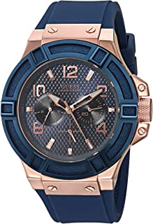 GUESS  Rigor Iconic Blue Stain Resistant Silicone Watch with Rose Gold-Tone Day + Date. Color: Blue (Model: U0247G3)