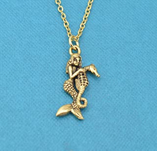 Mermaid riding a seahorse necklace in gold plated pewter on a 18 gold stainless steel cable chain with two inch extender. Mermaid necklace.