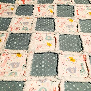 Baby rag quilt dusty green with a sweet print of giraffes lions elephants in peach dusty green blue and yellow