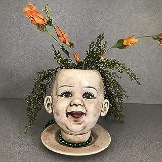 creepy doll head planter