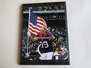 "J.J. WATT LEADS THE HOUSTON TEXANS ON THE FIELD HOLDING THE AMERICAN FLAG PHOTO MOUNTED ON A""9 X 12"" BLACK MARBLE PLAQUE"