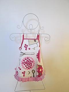 Tablier fille à froufrou en tissu écru avec des ustensiles de cuisine 4/6 ans