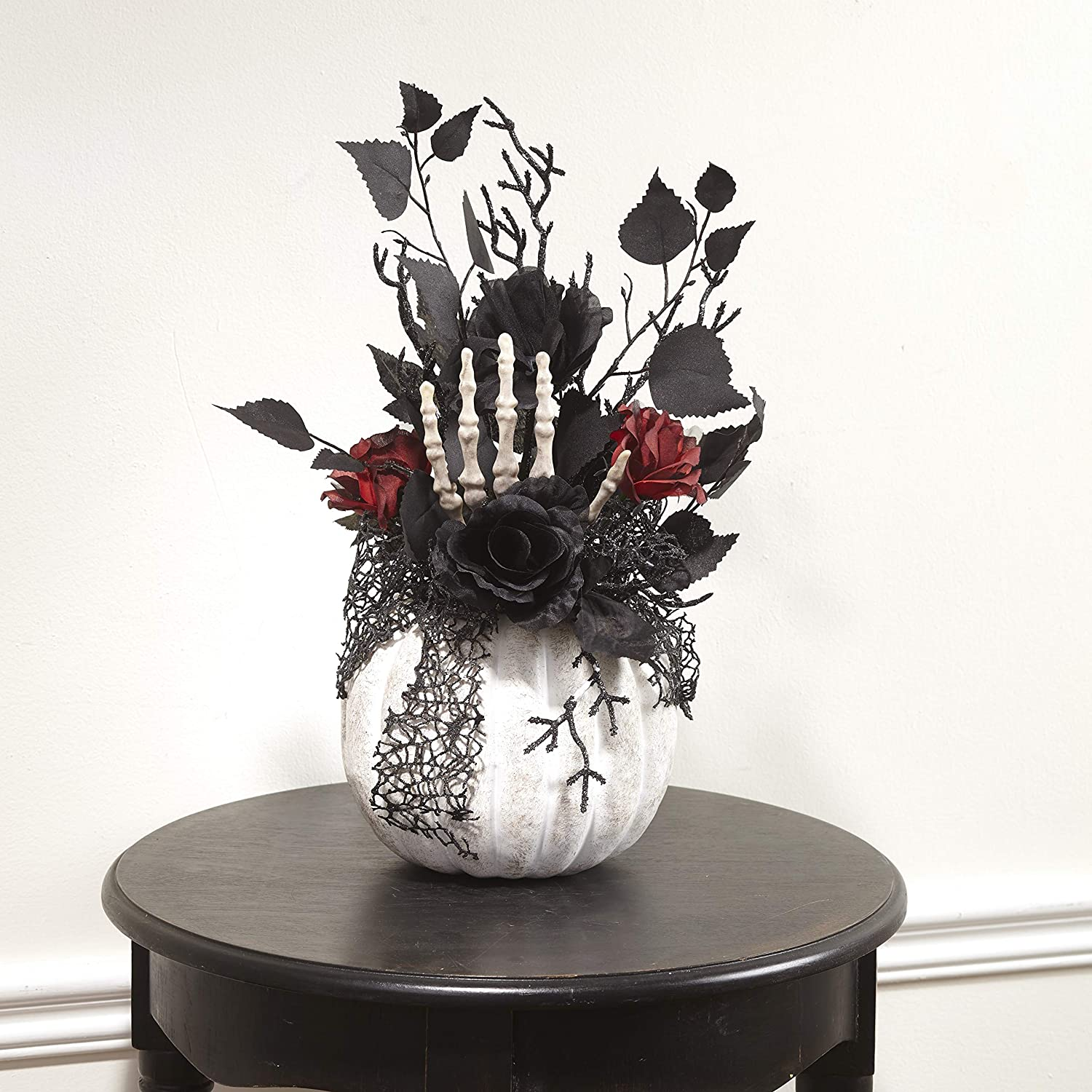 The Lakeside Collection Gothic Style Tabletop Pumpkin with Faux Floral Plants and Skeleton Hand