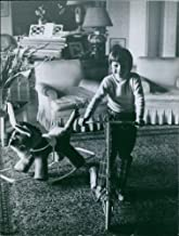Vintage photo of Young Prince Ali Salman Aga Khan riding on his scooter inside their house.