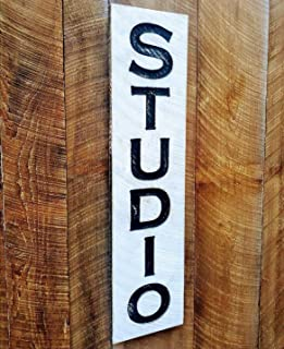 Vertical Studio carved sign at 40