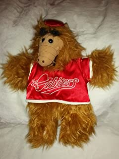Vintage Alf Puppet wearing a red hat and red Orbiters jersey