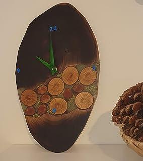 Reloj de pared ovalado de madera