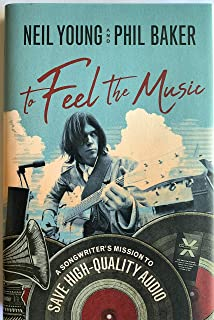 Neil Young signed book to feel the music phil baker 1st edition in store signing
