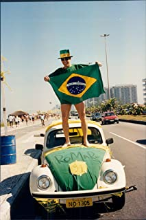 Vintage photo of Ecstatic Brazilians greet their returning World Cup Champion ship team with enthusiastic victory celebrations in the streets of Rio, July 19, 1994.