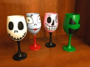 Part of the gang from Nightmare Before Christmas painted wine glasses