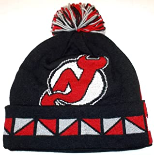 2595d772abbaa3 Mitchell And Ness Nhl 2 Face Current Knit Hat With Pom DEVILS