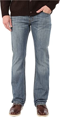 527 Slim Boot Cut Jeans in Medium Chipped