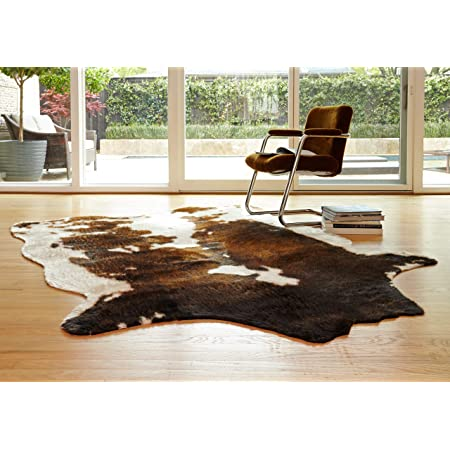 Amazon Com Safavieh Cow Hide Collection Coh211c Handmade Rustic Genuine Cowhide Area Rug 4 X 6 Black Brown Furniture Decor