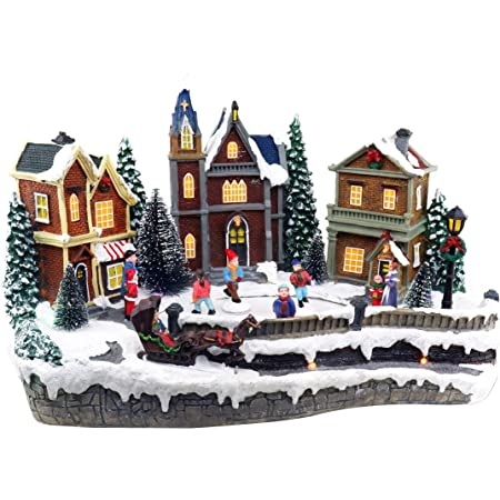 Amazon Com Skating Christmas Village Animated Pre Lit Musical Winter Snow Village With 4 Moving Skaters Perfect Addition To Your Christmas Indoor Decorations Christmas Village Displays Kitchen Dining