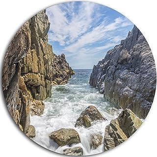 Designart Sea Waves Hitting Rocky Shore Modern Seascape Round Metal wall Art - Disc of 23, 23X23-Disc of 23 inch, Blue