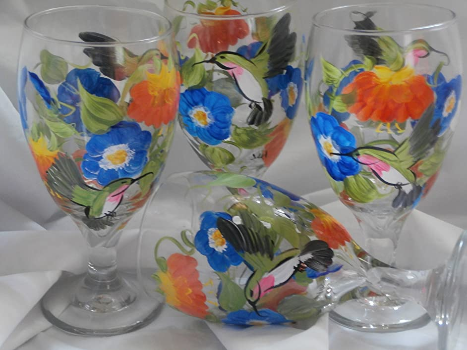 Hand painted hummingbirds, morning glories and fuchsia's. So pretty. Set of 4. 16 ounce short stemmed ice tea/water glasses. . Oranges, blues and greens