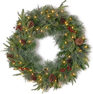 National Tree 24 Inch Feel Real Colonial Wreath with 8 Pine Cones, 8 Red Berries and 50 Dual Color Battery Operated LED Lights with Timer and 9 Functions (PECO7-395D24WBC)