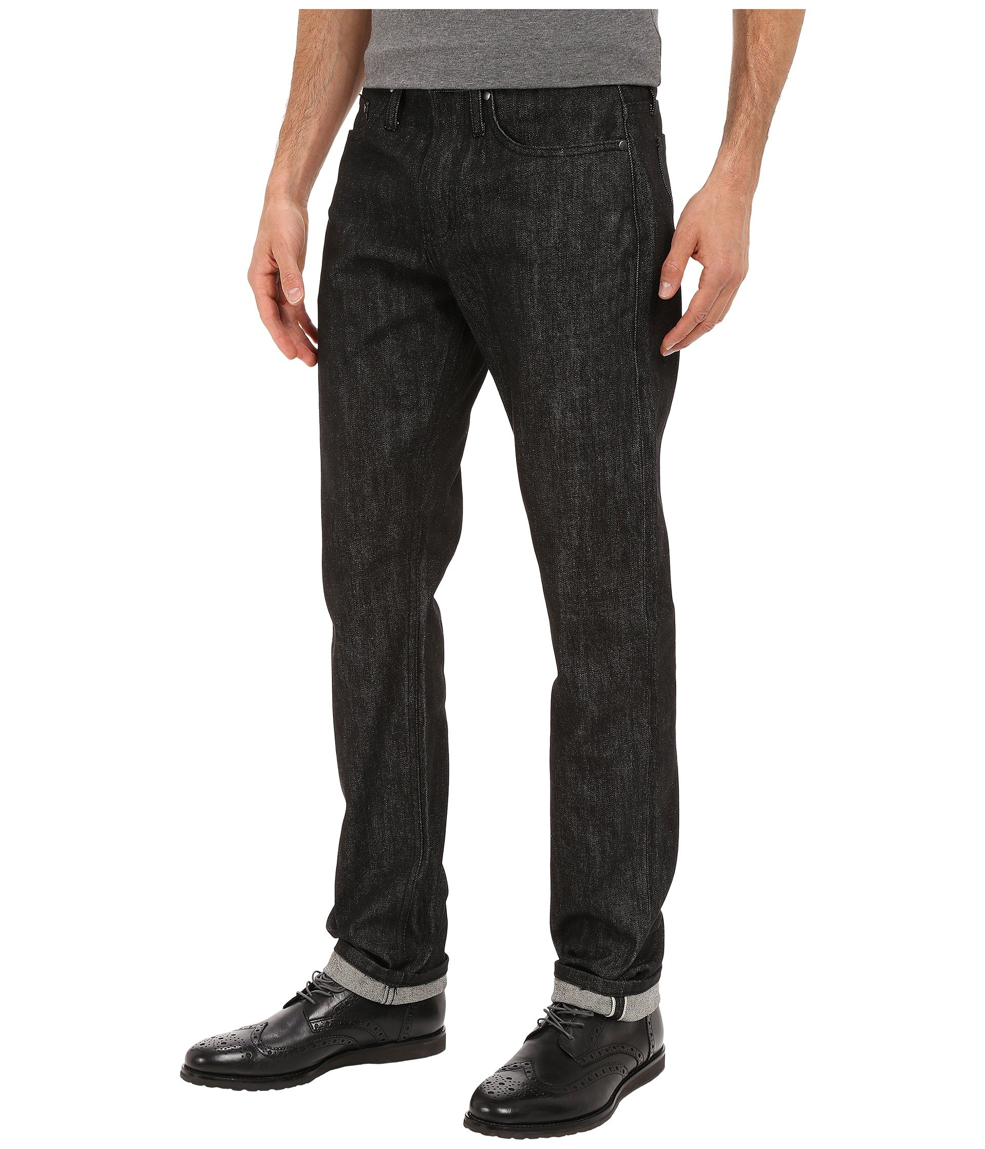 The Unbranded Brand Tapered Jeans in Black Selvedge at ...