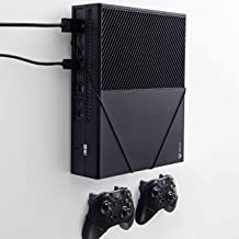 Wall mount for Xbox One Original by FLOATING GRIP® - This package (BUNDLE) incl. mounts for 1x console and 2x controllers. Color: Black. Patent pending and proprietary design by FLOATING GRIP®