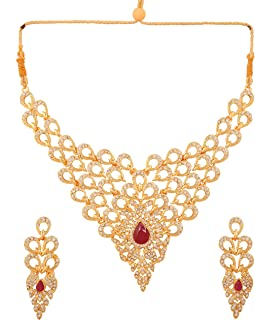 Touchstone Indian Bollywood traditional royal white Rhinestone and candy red faux ruby bridal designer jewelry necklace set for women in gold tone