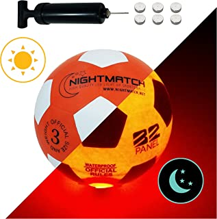 NightMatch Light Up Soccer Ball Kids Edition INCL BALL PUMP and SPARE BATTERIES - Inside LED lights up when kicked - Glow in the Dark Soccer Ball - Youth Size 3 - Official Size & Weight - orange/white