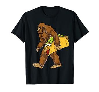 5d556b77ee Amazon.com: Bigfoot Carrying Taco T shirt Cinco de Mayo Boys ...